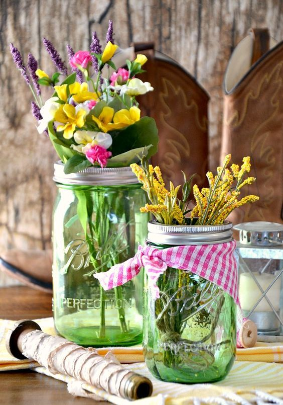 green jars with checked fabric and fresh spring blooms