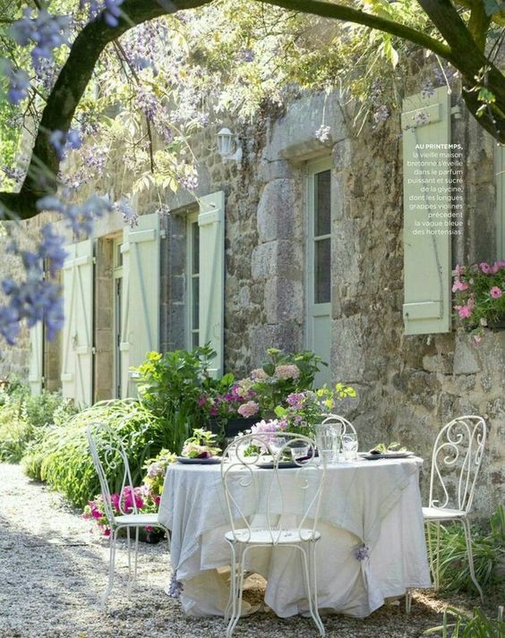refined white forged furniture is ideal for a French country outdoor space