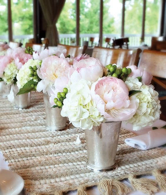 silver ice buckets used as vases for delicate flowers