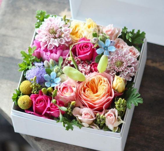 a box filled with various blooms is a cute and easy idea