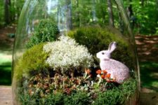 18 a simple jar terrarium with a little bunny and several kinds of moss