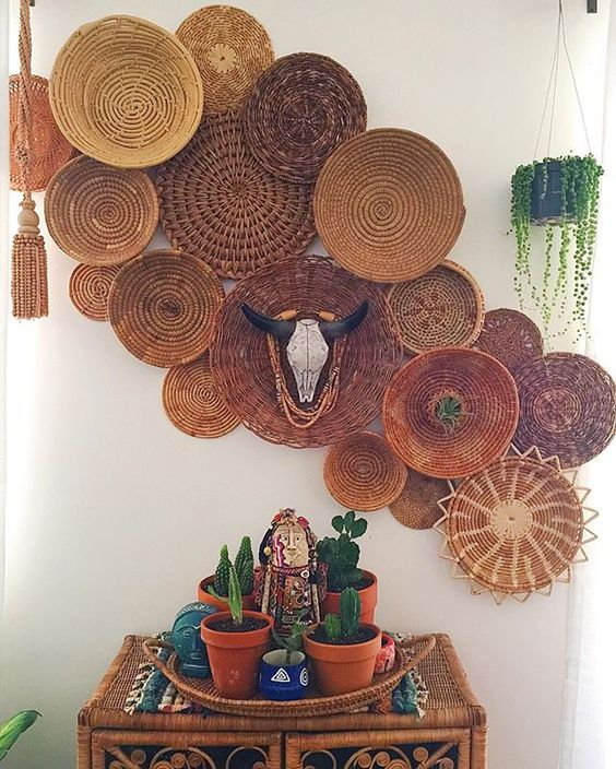 a wicker cabinet with cacti and a wall basket composition with a faux skull for a desert feel
