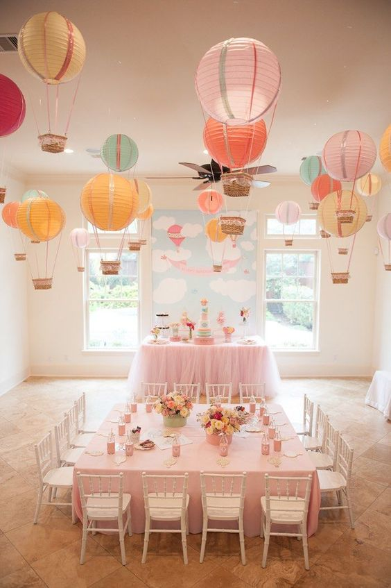 hot air balloon hanging over the space made with paper lanterns