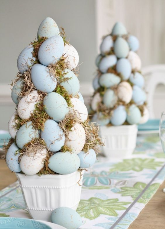 pastel blue egg trees with moss in pots can decorate your table