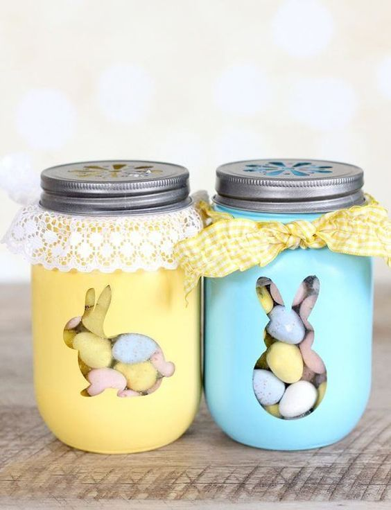 pastel painted jars with colorful candies with lace