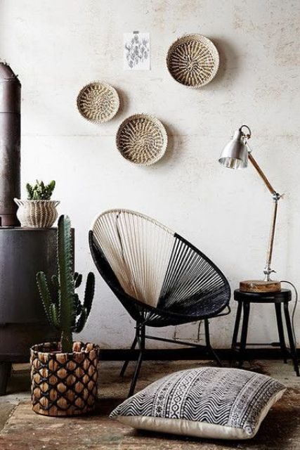 some wall baskets and a matching planter and rug