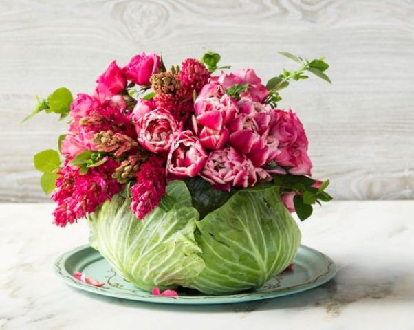 hollow out a hole in a head of cabbage large enough to accommodate a mason jar and fill it with bold flowers