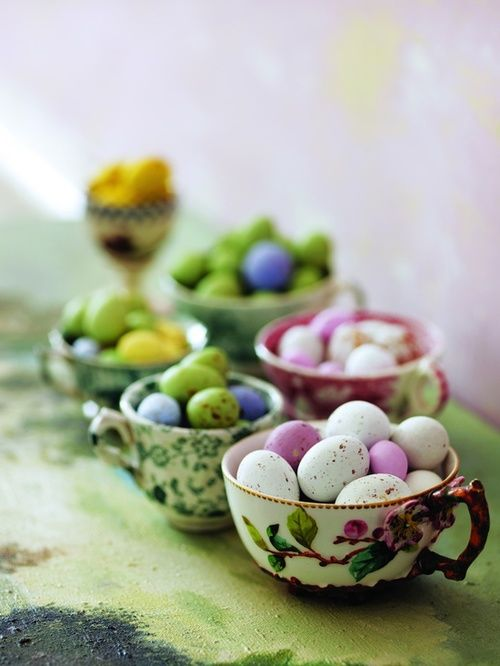 vintage tea cups with dyed Easter eggs