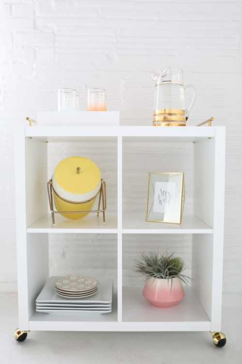 DIY Ikea Kallax bookshelf into a cool bar cart (via www.shelterness.com)