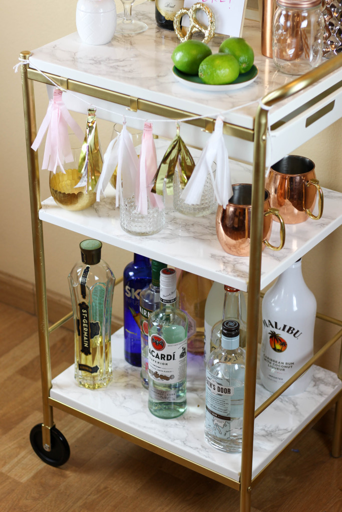 DIY Ikea Bygel into a glam marble and gold bar cart (via twinspiration.co)