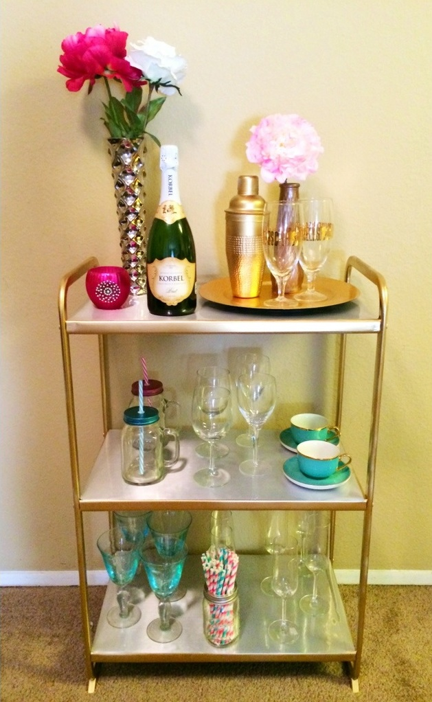 DIY Ikea Mullig shelving unit into a bar cart (via twinspiration.co)