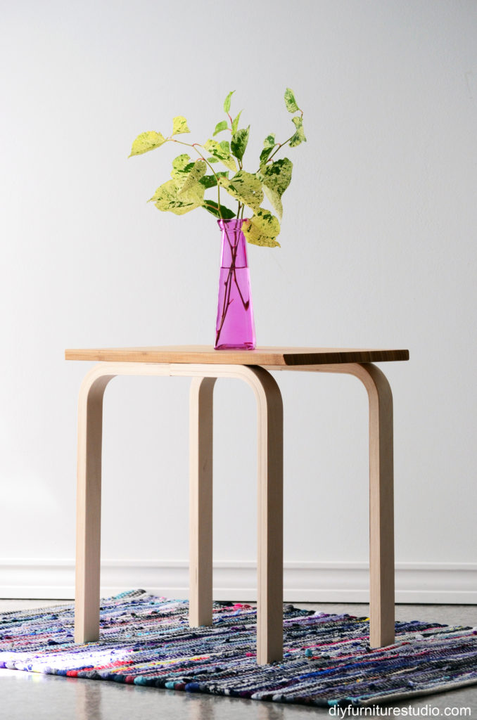 DIY Ikea Frosta stool with a copping board into a side table (via diyfurniturestudio.com)