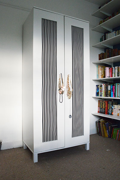 DIY Ikea aneboda wardrobe hack with bold fabric (via www.ohhidiy.com)