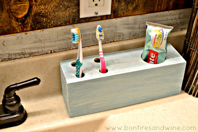 DIY toothbrush holder from an old box (via www.bonfiresandwine.com)