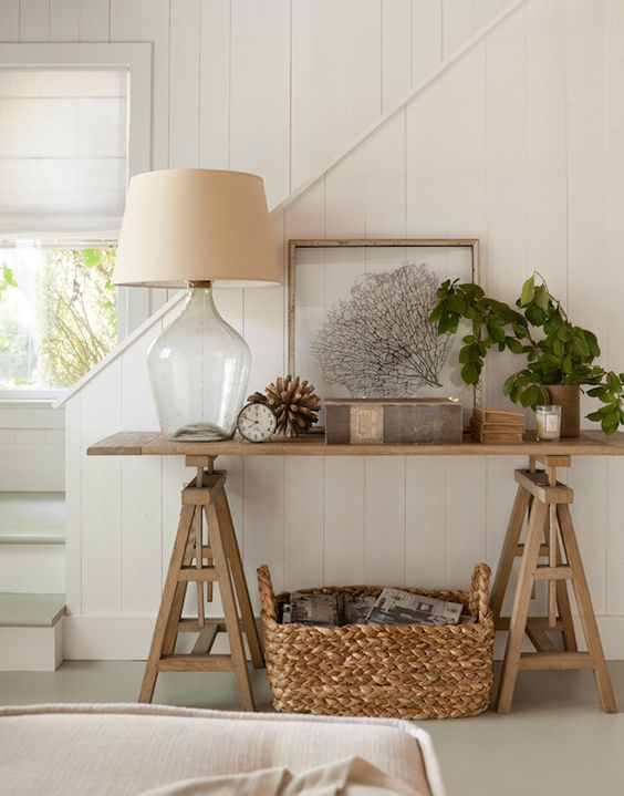 a basket for storage under the console table is a cute idea