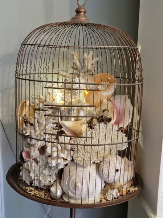 a bird cage filled with sea creatures and pearls is a gorgeous artwork idea