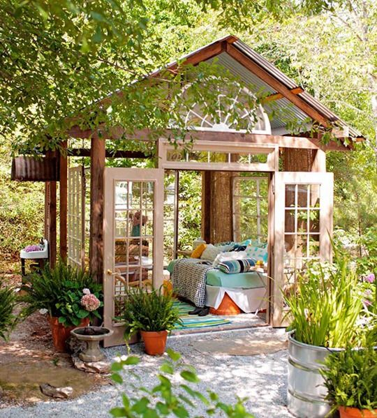 a former greenhouse turned into an outdoor bedroom is a perfect idea to save you from insects or excessive cold