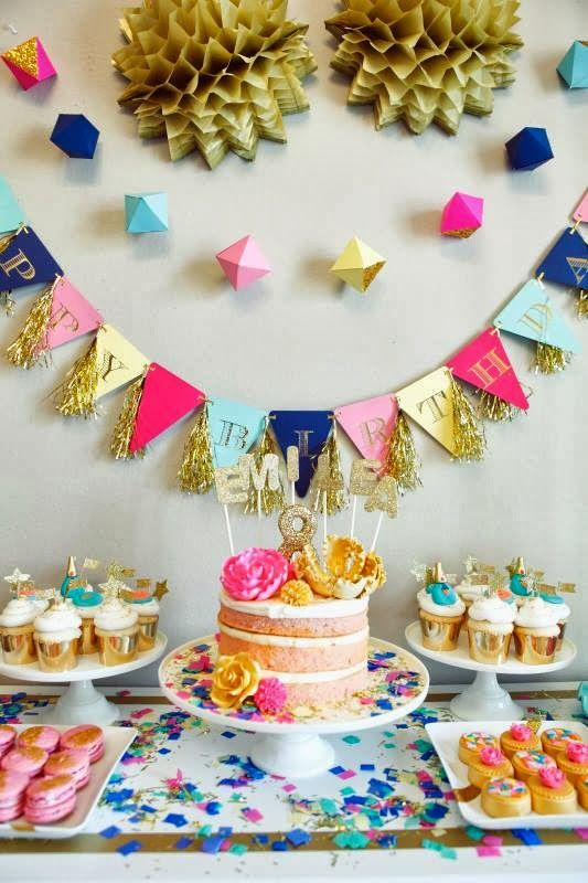 a geometric garland and dimensional geo hangers over the dessert table