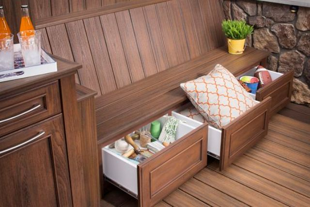 a stained wooden bench with storage drawers