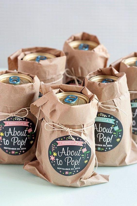 beer or soda cans covered in paper bags with tags look cute