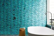 02 teal and turquoise fish scale tiles in the shower zone create a show-stopping impression