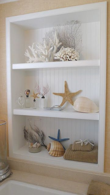 a display shelf with corals, starfish, shells is great for bathrooms