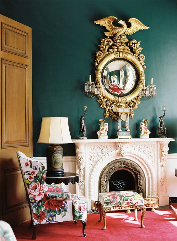 a vintage armchair and footrest with bold colorful florals