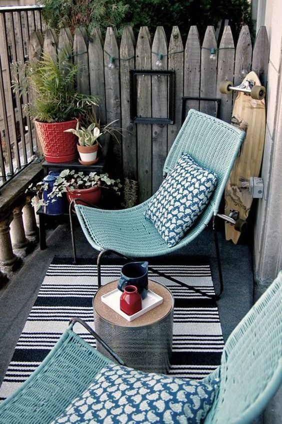 aqua-colored wicker chairs and a tiny round coffee table