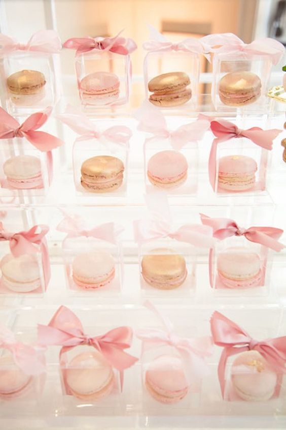 blush macarons packed in individual boxes with ribbon bows