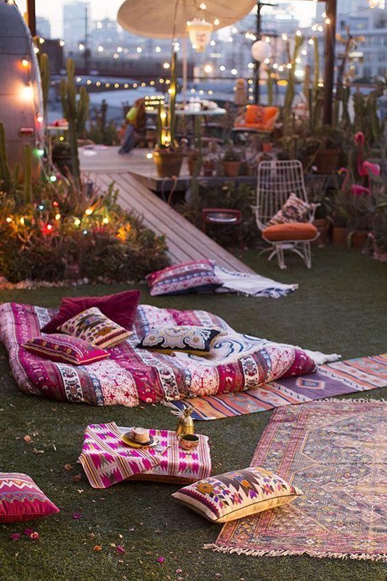 bold printed textiles and pillows placed right on the grass is everything you need