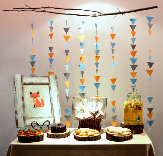 colorful triangle garlands as a dessert table backdrop