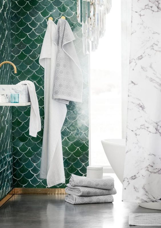 one green fish scale tile wall for a bold statement in a marble bathroom