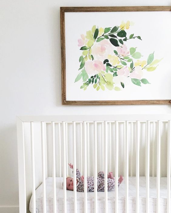 soft pastel floral artwork in a simpel wooden frame