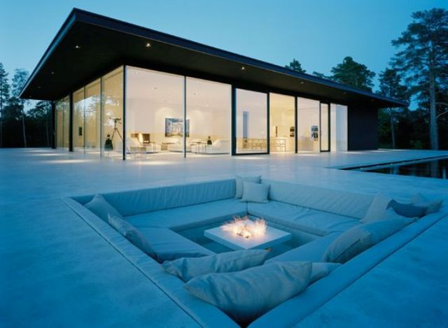 stunning minimalist all-white conversation pit with a modern fireplace