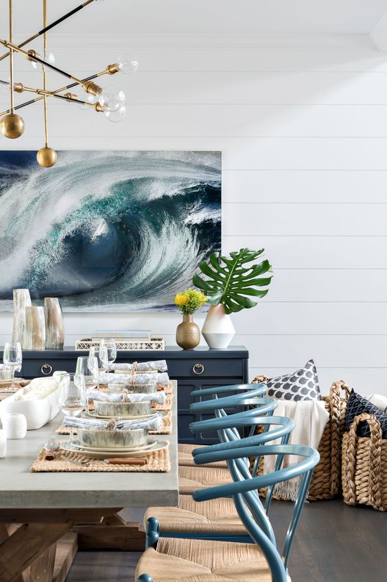 an ocean swirl artwork in the dining room makes a bold statement