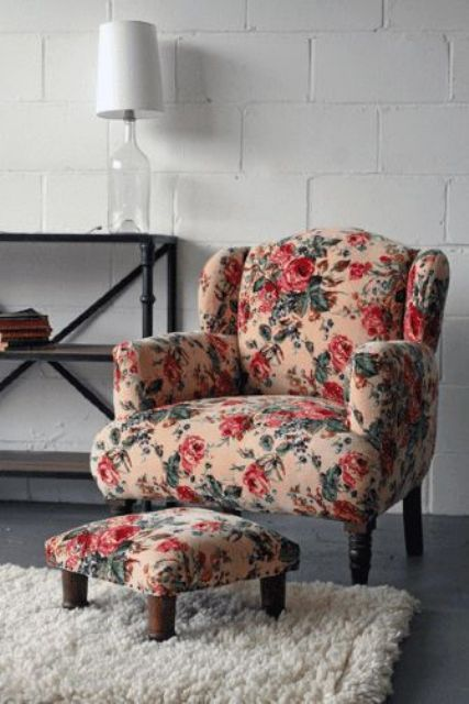armchair with a footrest with red flowers and leaves in vintage style