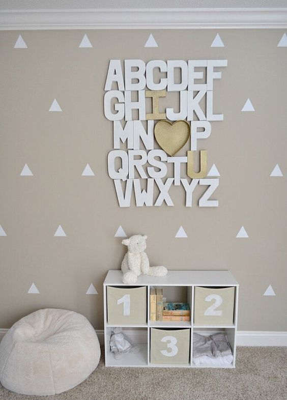 cardboard letters with a heart will help to study the alphabet