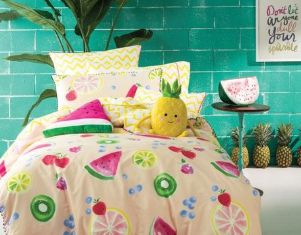fun bedding with kiwi, lemon, strawberry and blueberry prints and a watermelon pillow