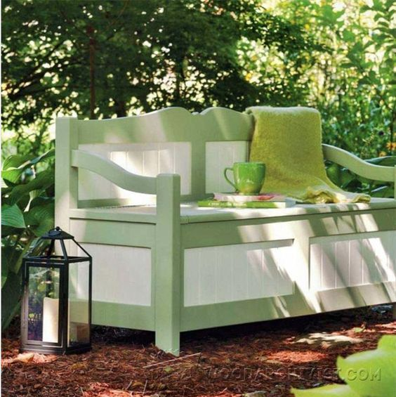 outdoor rustic styled bench in green and white and with storage space inside