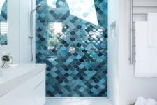 04 shower area clad with fish scale tiles in the shades of blue