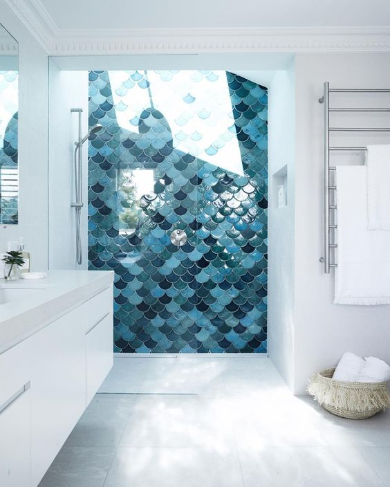 shower area clad with fish scale tiles in the shades of blue