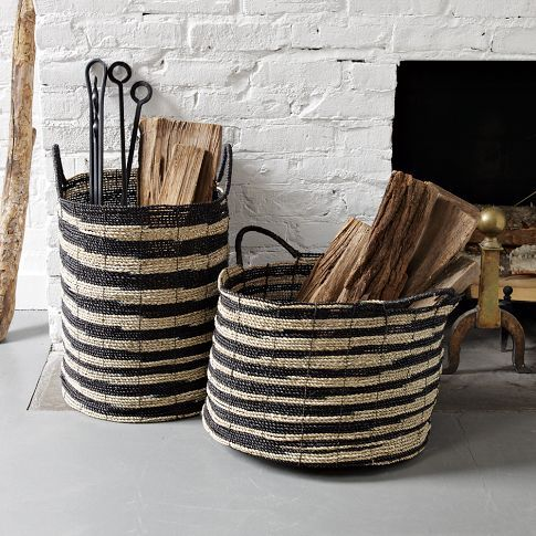 striped baskets for storing firewood and other fireplace-connected stuff
