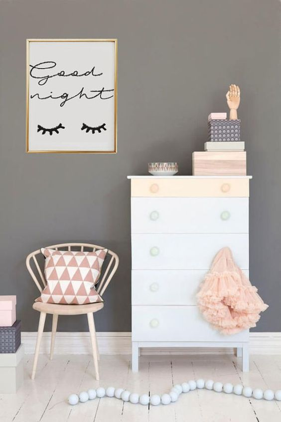 a cute girlish art with eyelashes in a gidled frame for stylish decor