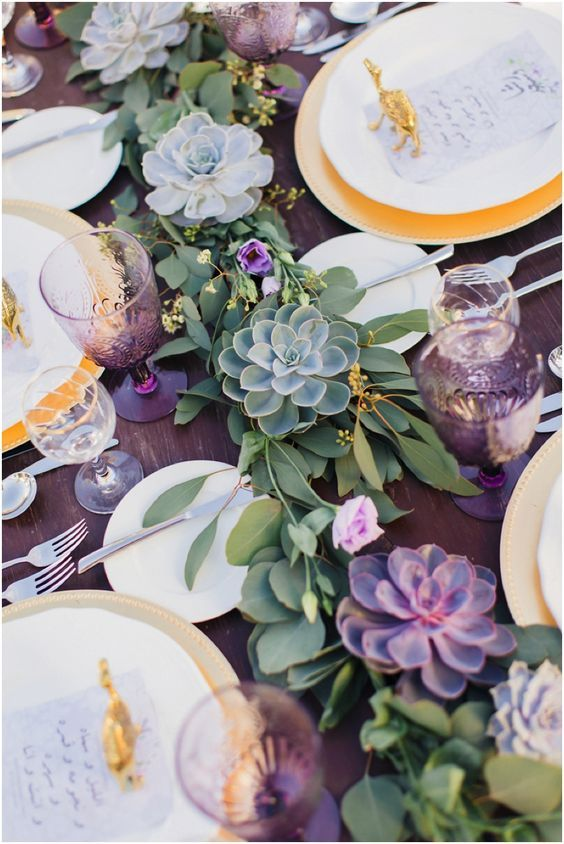 a lovely greenery and green succulent garland along the whole table