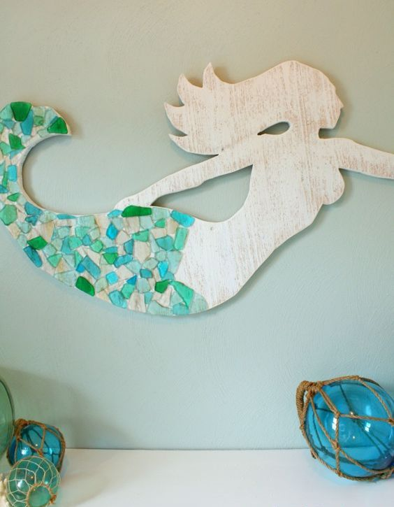 a mermaid artwork covered with sea glass - Mermaid Home Decor