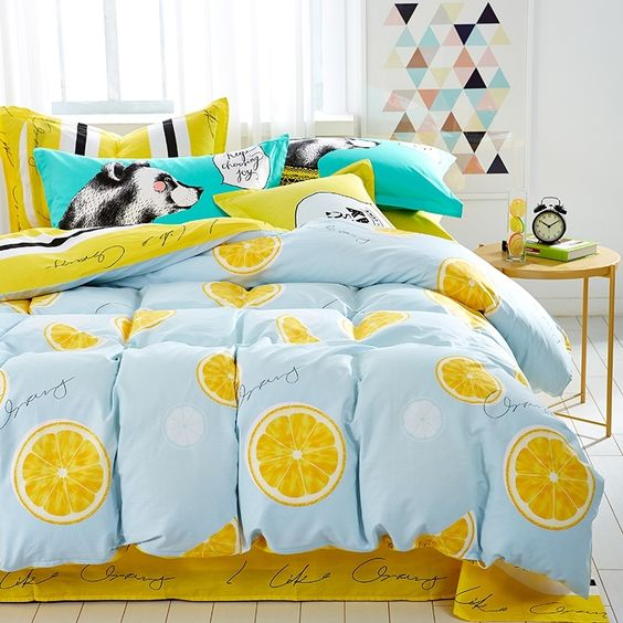 funky blue and yellow orange printed bedding for teenage bedroom