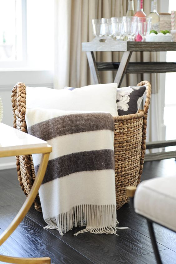 put your blankets and throws into a large basket to avoid mess