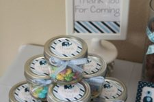 06 candy favors in jars with elephant tags for an elephant-theme baby shower