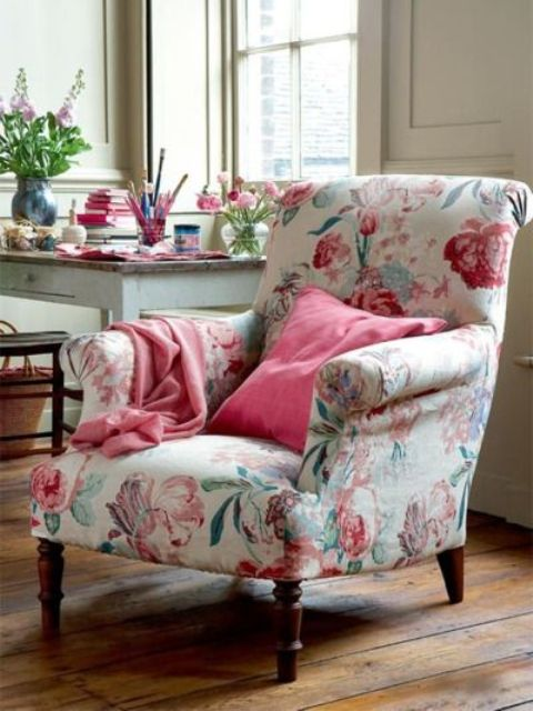 delicate floral armchair with pink flowers and green leaves on a creamy backdrop