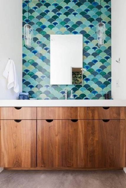Simple fish scale tile sink wall in the shades of blue and green
